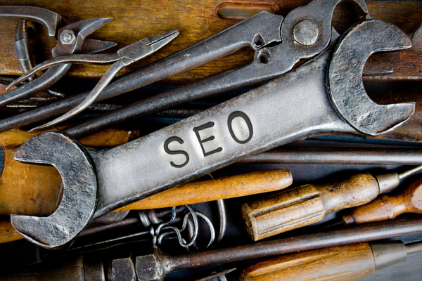 SEO engraved on a wrench. SEO tools concept.